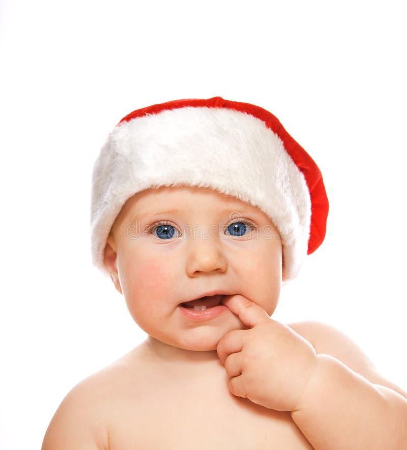 Criança adorável no chapéu do Natal isolado no whit imagem de stock royalty free