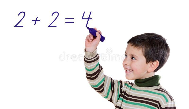 Criança adorável que escreve uma soma imagens de stock