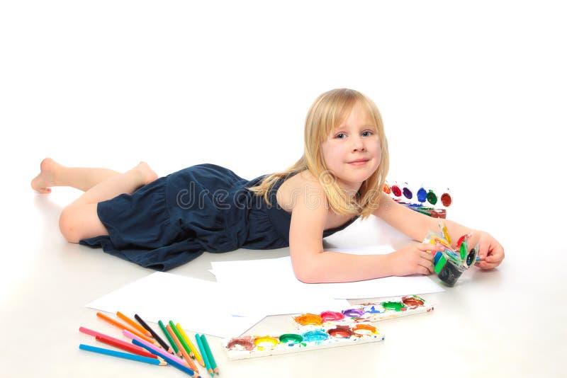 Criança alegre com pintura imagens de stock royalty free
