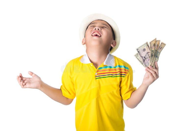 Criança asiática que guarda o dinheiro ao estar isolado no backg branco fotos de stock royalty free