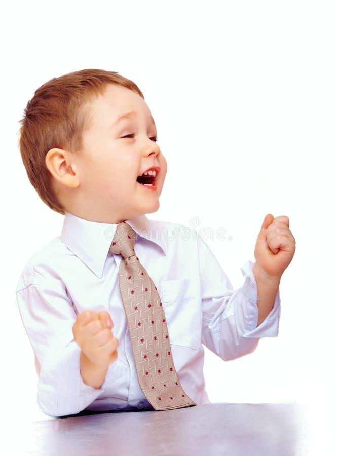 Criança bem sucedida do negócio que expressa a positividade imagem de stock royalty free