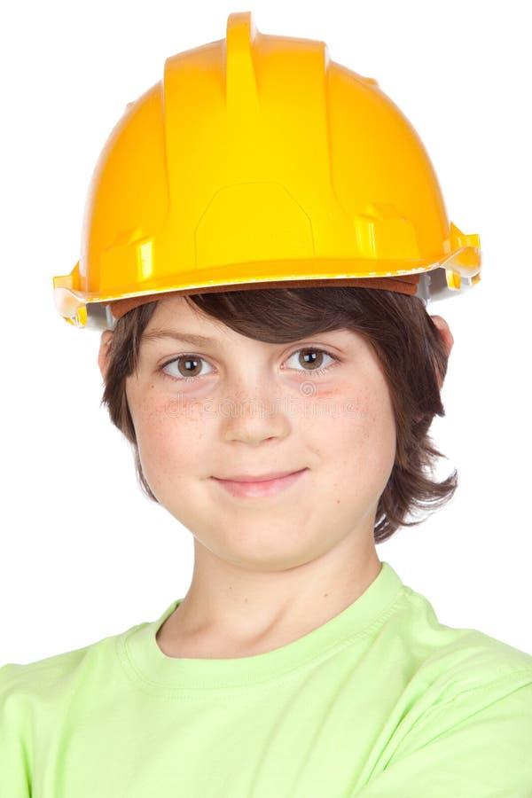 Criança bonita com capacete amarelo fotos de stock