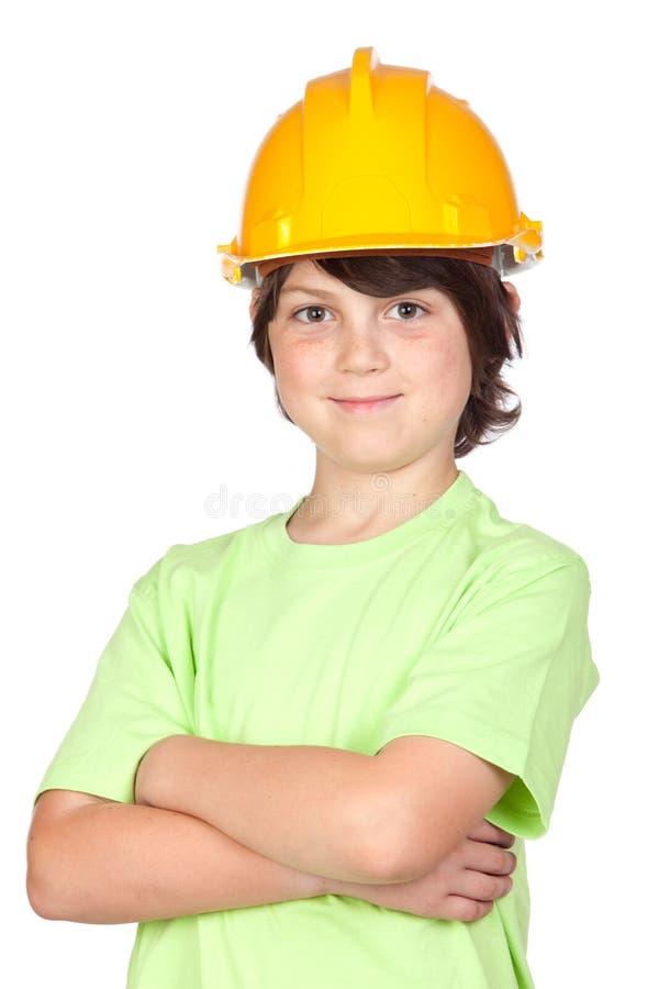 Criança bonita com capacete amarelo fotos de stock royalty free