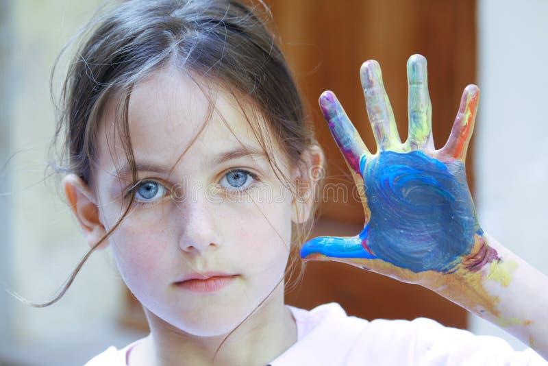 Criança bonita com pintura fotos de stock royalty free