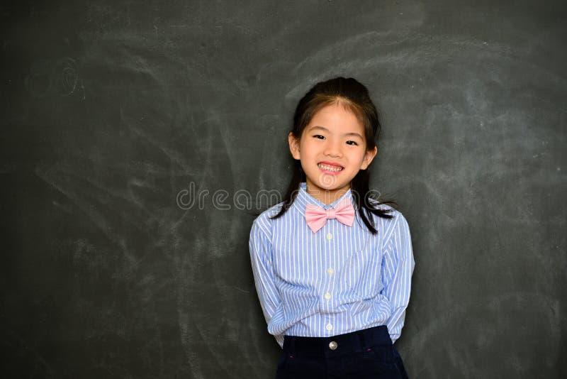 A criança bonita da menina veste-se acima como o professor foto de stock