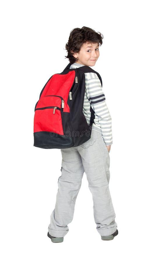 Criança bonita do estudante com trouxa pesada imagens de stock royalty free