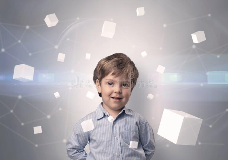 Criança bonito com cubos luminosos ao redor foto de stock