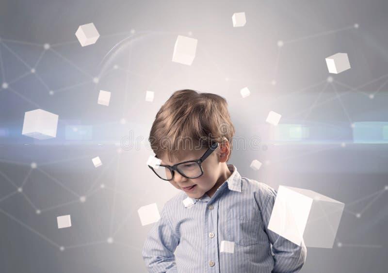 Criança bonito com cubos luminosos ao redor foto de stock royalty free