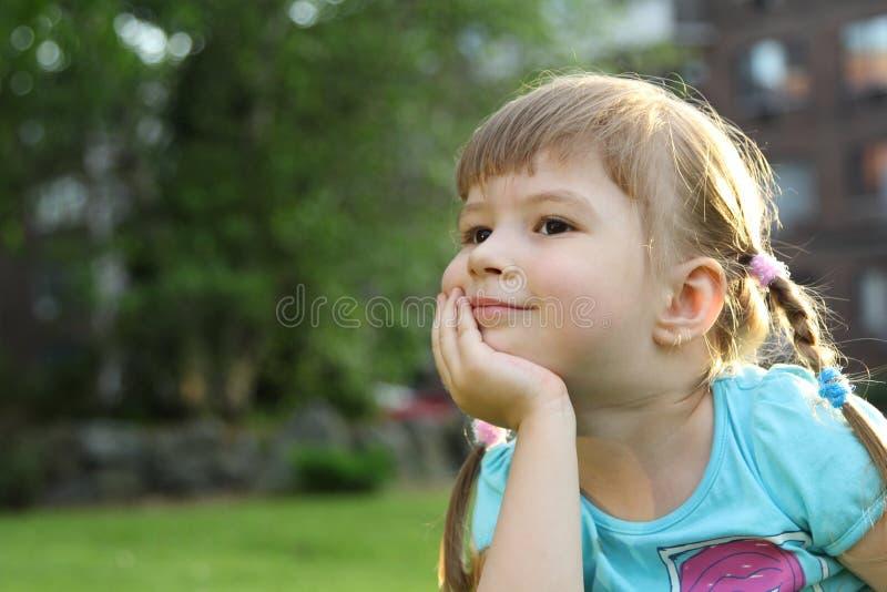 A criança bonito está sorrindo imagem de stock royalty free