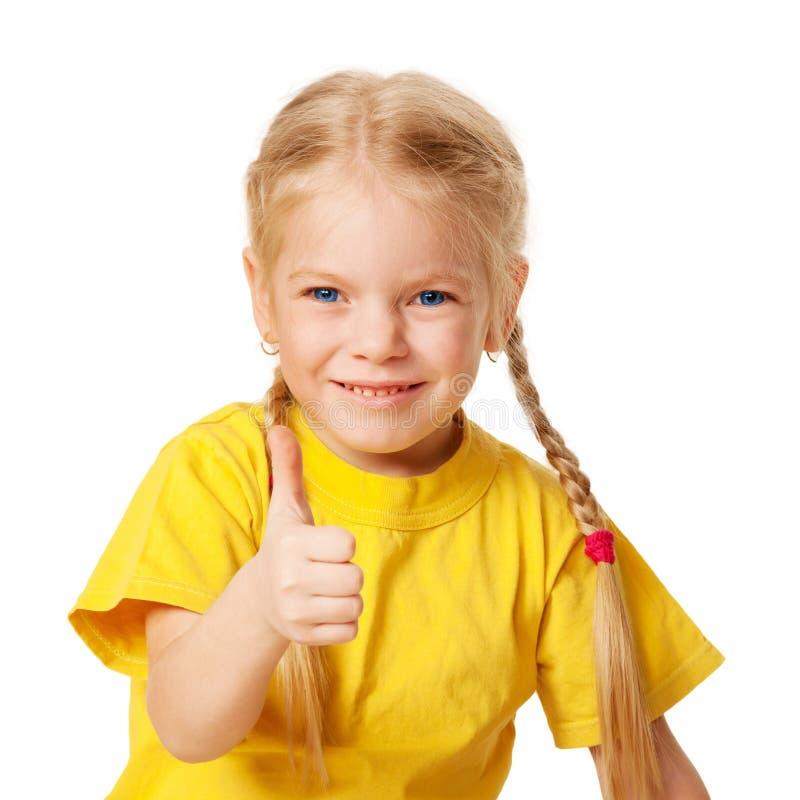 Criança bonito que mostra os polegares acima. Isolado no branco imagens de stock royalty free
