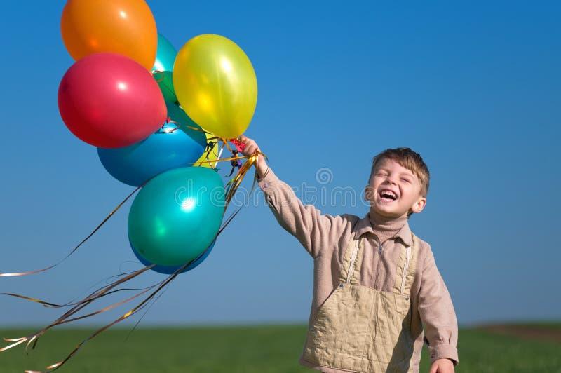 Criança com balões fotos de stock