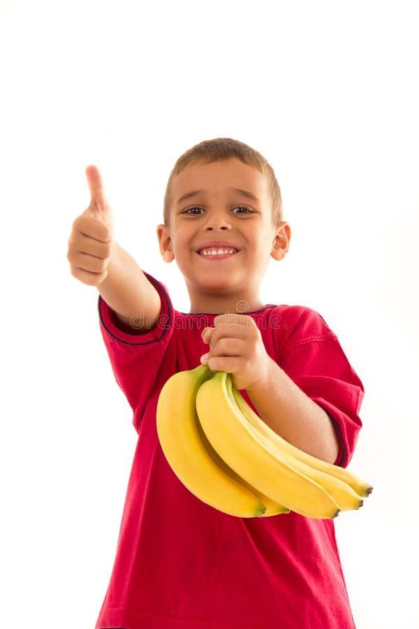 Criança com banana foto de stock
