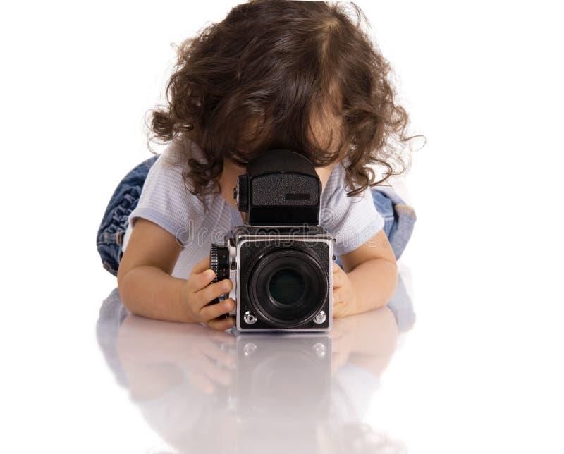 Criança com câmera imagem de stock
