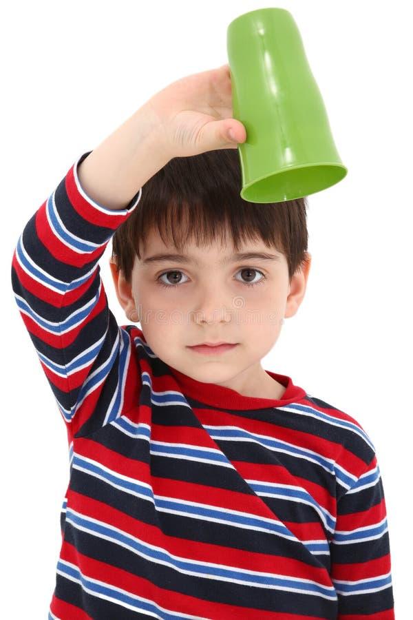 Criança com copo vazio fotos de stock royalty free