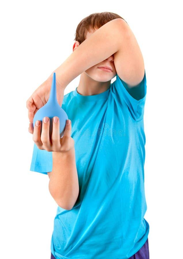 Criança com enema fotografia de stock