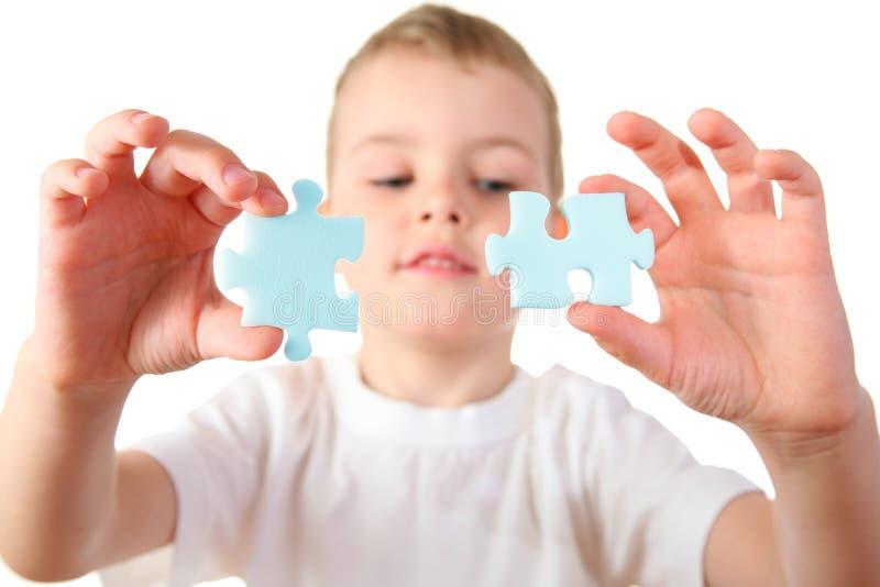Criança com enigma foto de stock royalty free