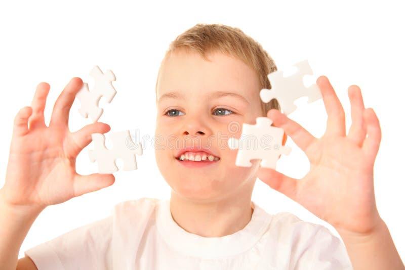 Criança com enigmas fotografia de stock royalty free