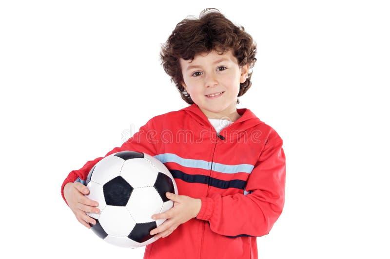 Criança com esfera de futebol foto de stock royalty free