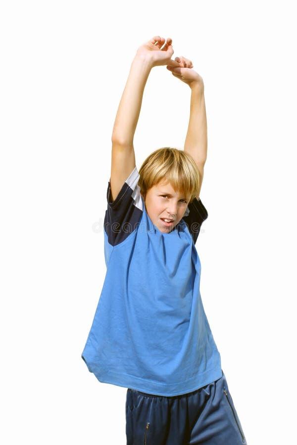 Criança com exercício levantado mãos ao ar livre fotos de stock royalty free