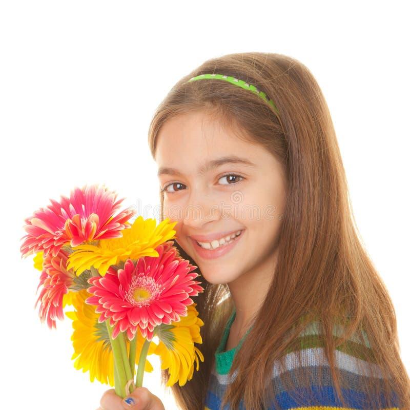 Criança com grupo de flores imagem de stock