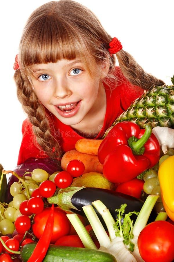 Criança com grupo de vegetal e de fruto. fotos de stock