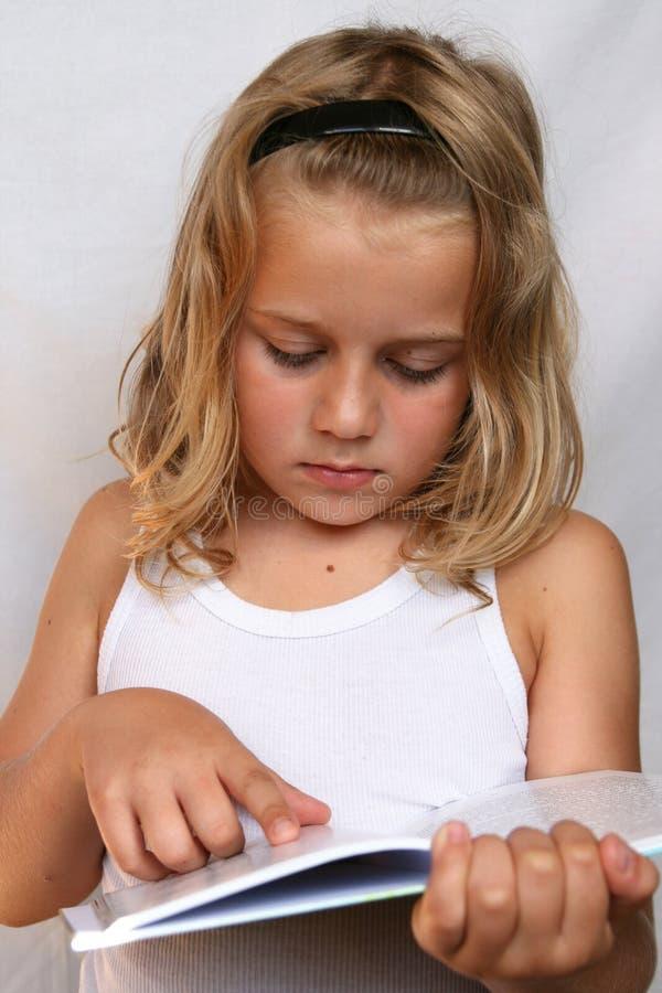Criança com livro foto de stock