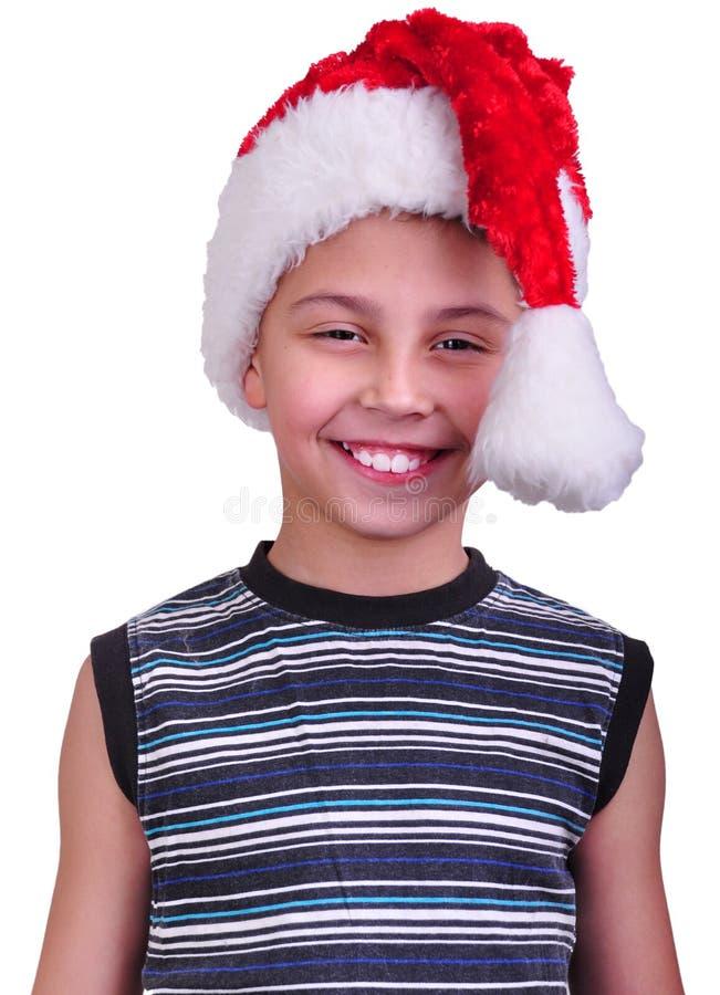Criança com o chapéu do vermelho de Santa Claus foto de stock