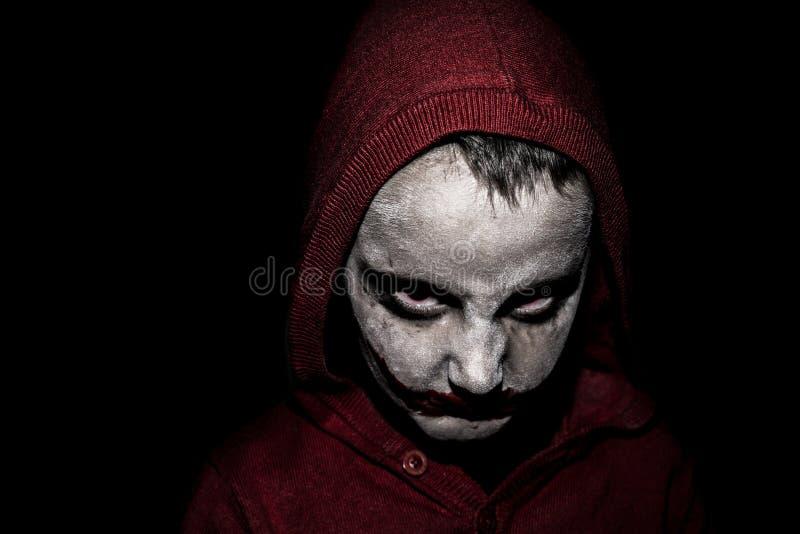 A criança com o Dia das Bruxas compõe fotografia de stock