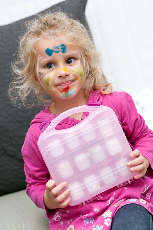 Criança com pintura da face fotografia de stock