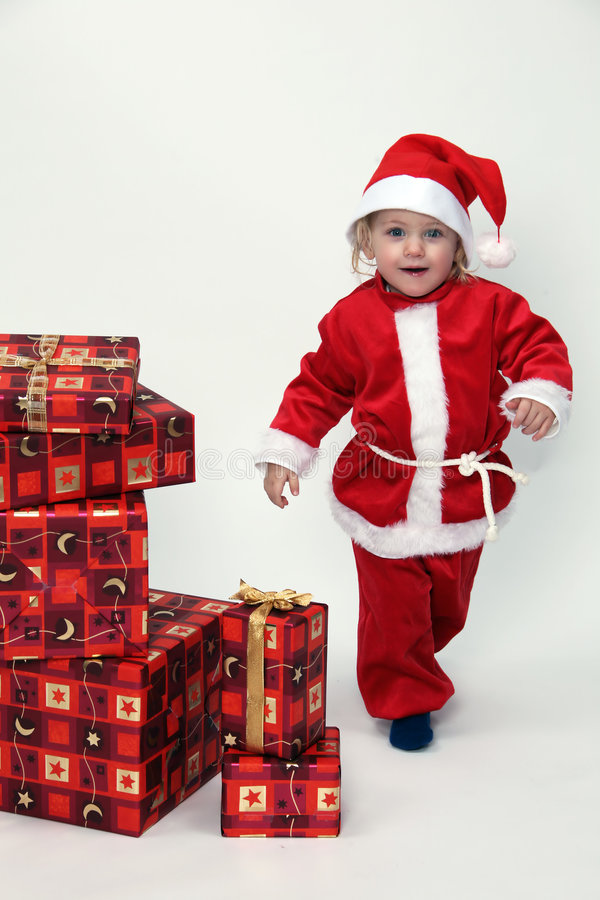 Criança com presentes do Natal imagem de stock
