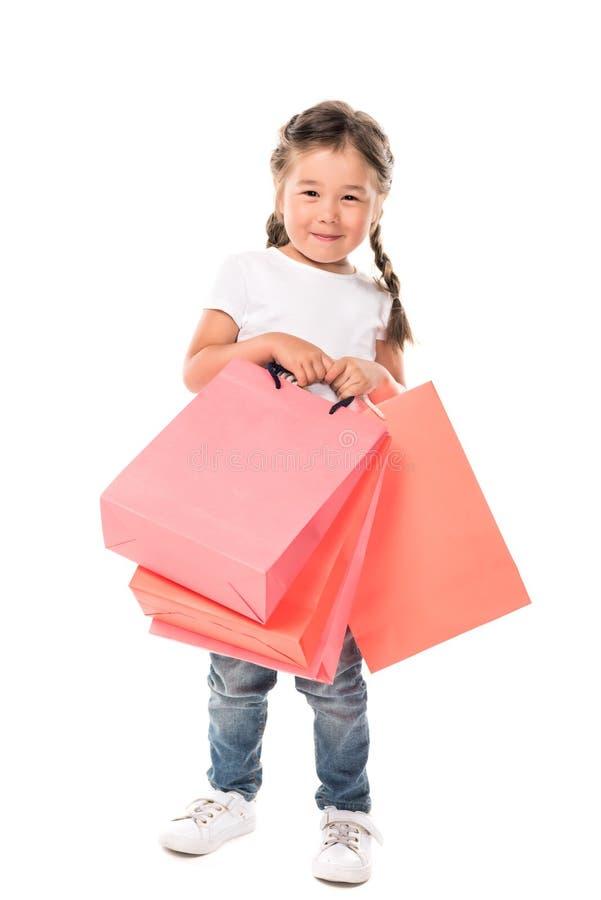 Criança com sacos de compras fotografia de stock royalty free