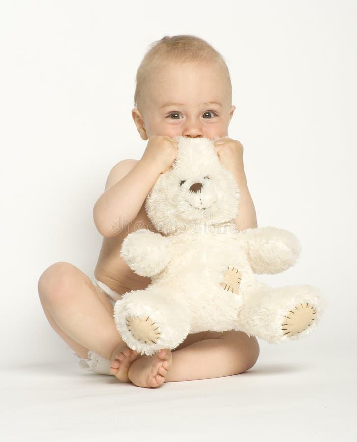 Criança com seu brinquedo imagem de stock royalty free