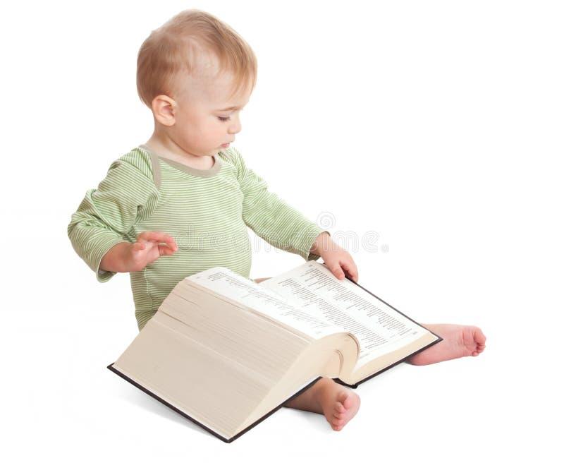 Criança com um livro imagens de stock