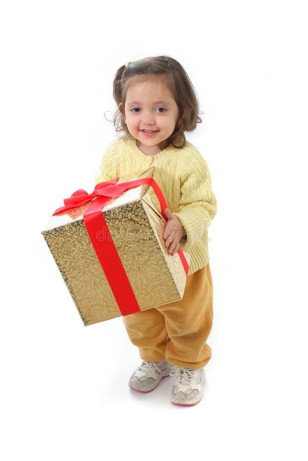Criança com um presente do Natal imagem de stock