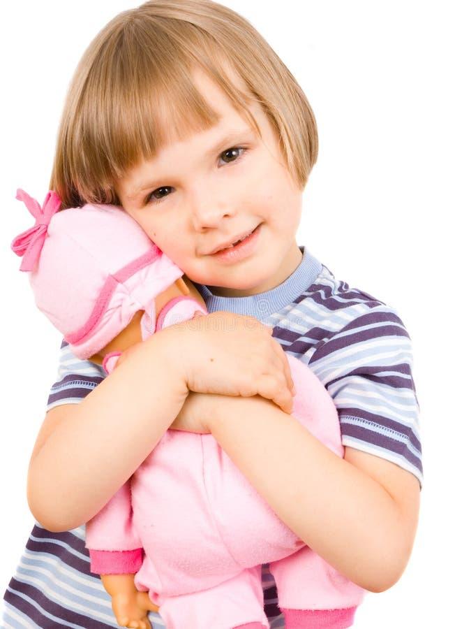 Criança com uma boneca fotos de stock