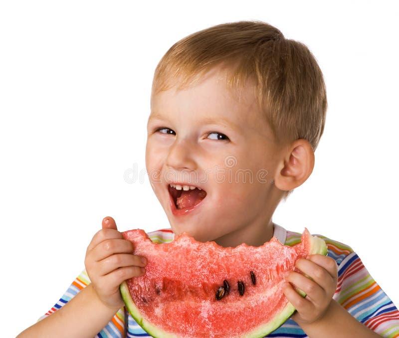 A criança com uma melancia fotografia de stock royalty free