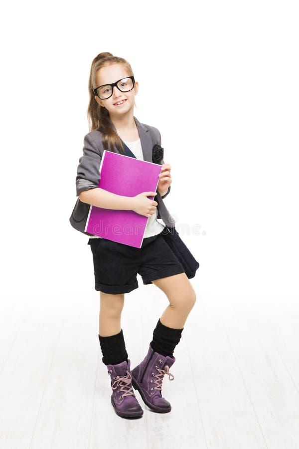 Criança da menina da escola nos vidros que guardam o livro Estudante Schoolgirl imagens de stock