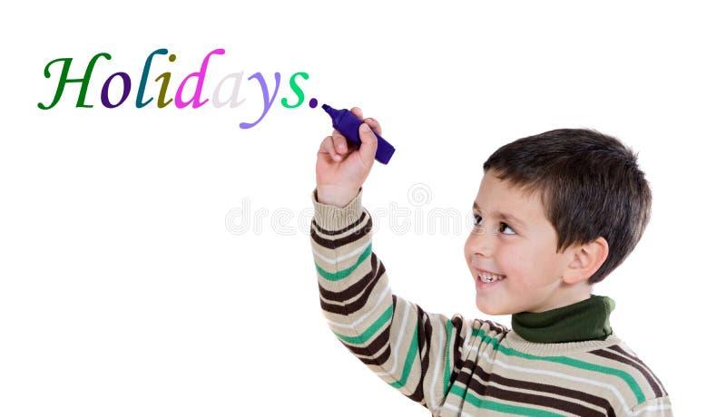 Criança de Adorables que escreve a palavra fotografia de stock
