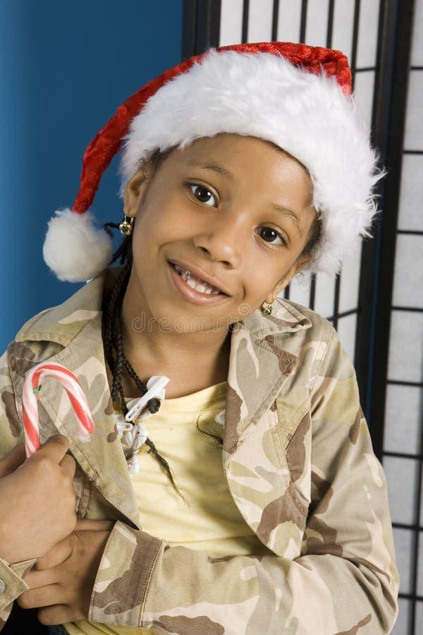 Criança de sorriso no chapéu de Santa foto de stock royalty free