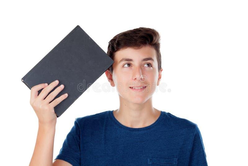 Criança do adolescente com um livro imagem de stock