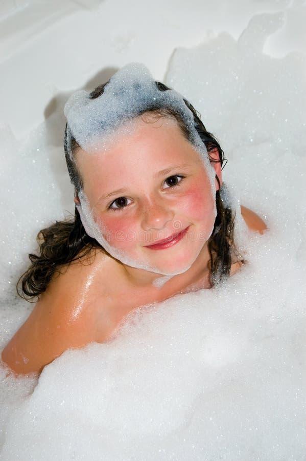Criança do banho de bolha imagem de stock