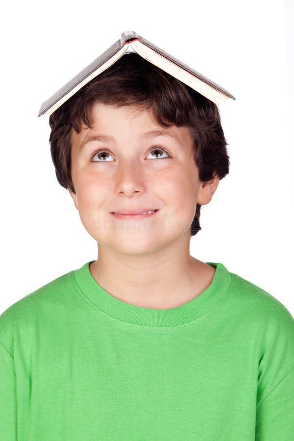 Criança do estudante com um livro fotografia de stock