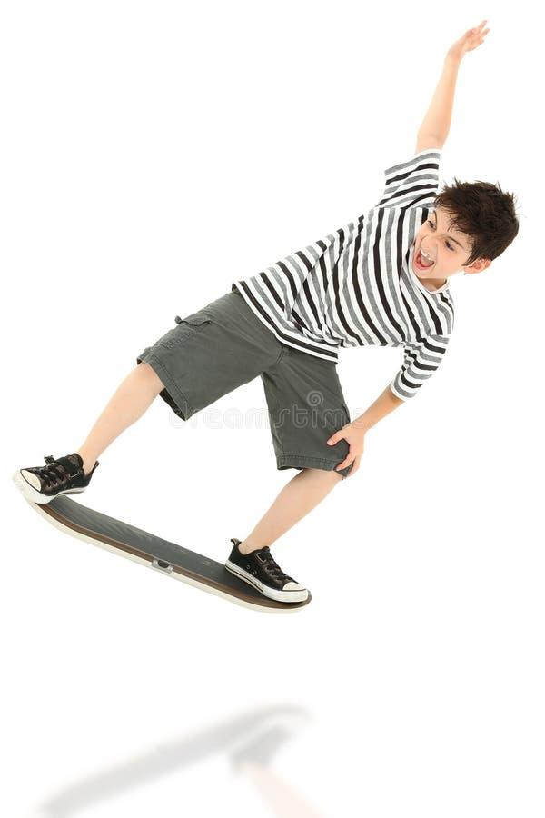 Criança do jogador do skate do jogo video foto de stock