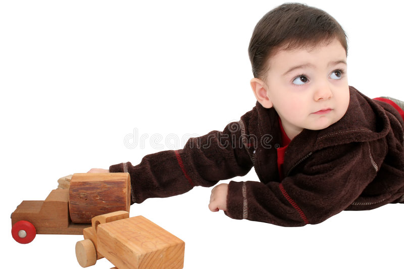 Download Criança Do Menino Com Os Carros De Madeira Do Brinquedo Foto de Stock - Imagem de rastejar, jogar: 55936