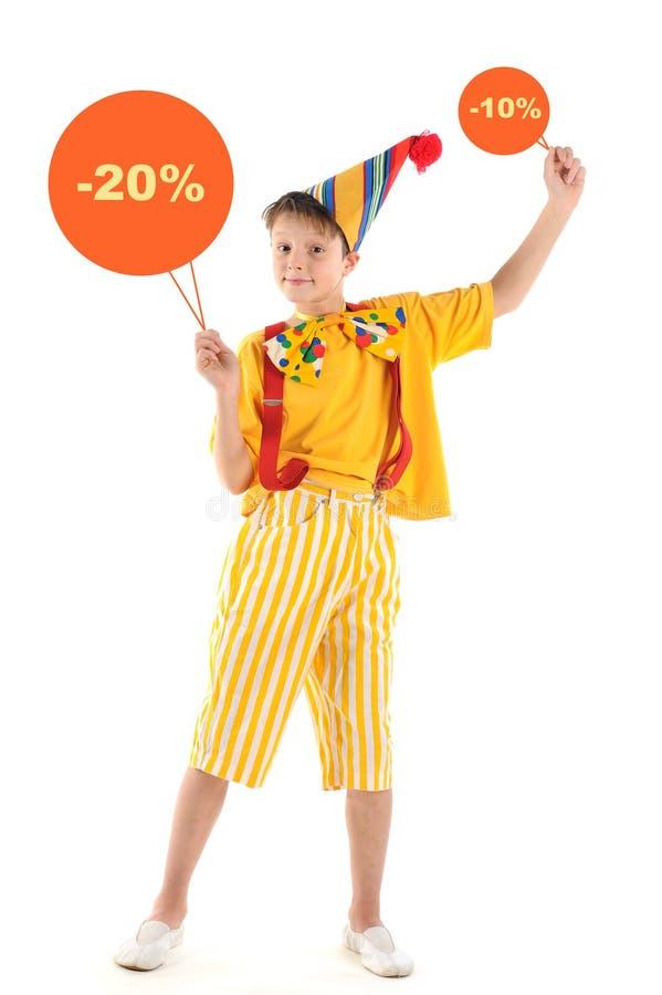Criança do palhaço com sinais dos discontos imagem de stock royalty free
