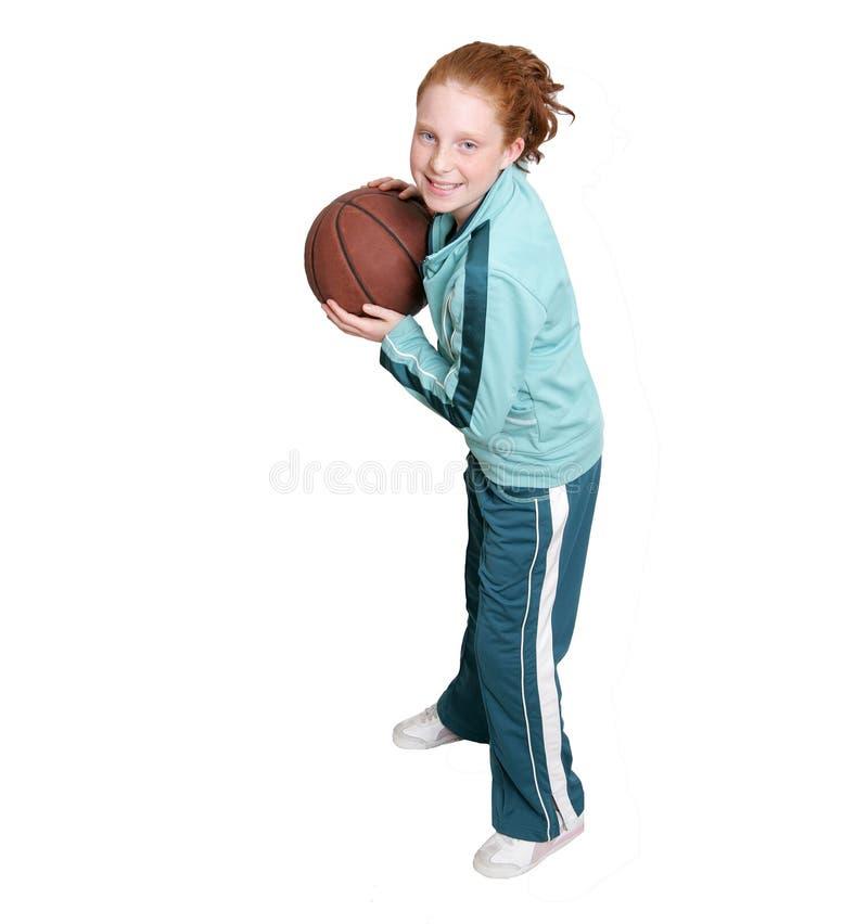 Criança e basquetebol do Redhead imagem de stock royalty free