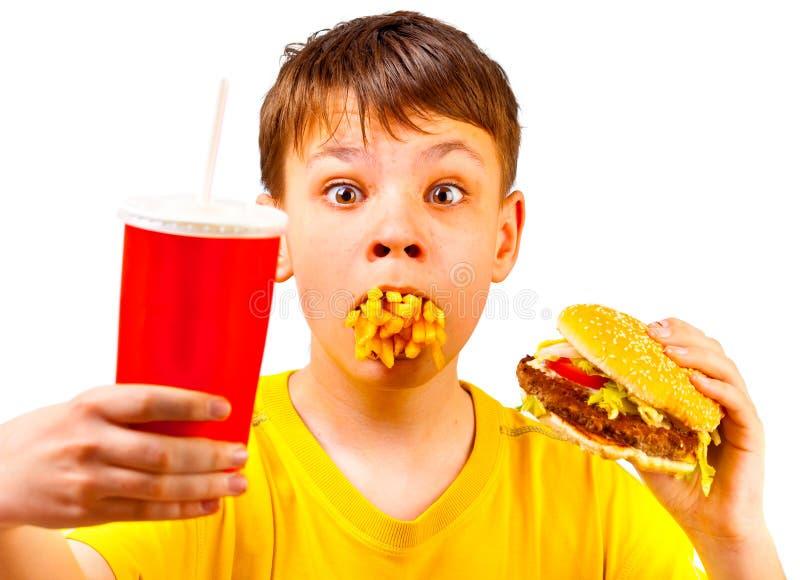 Criança e fast food foto de stock