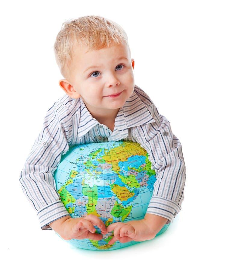 Download Criança e globo imagem de stock. Imagem de mão, global - 12808499