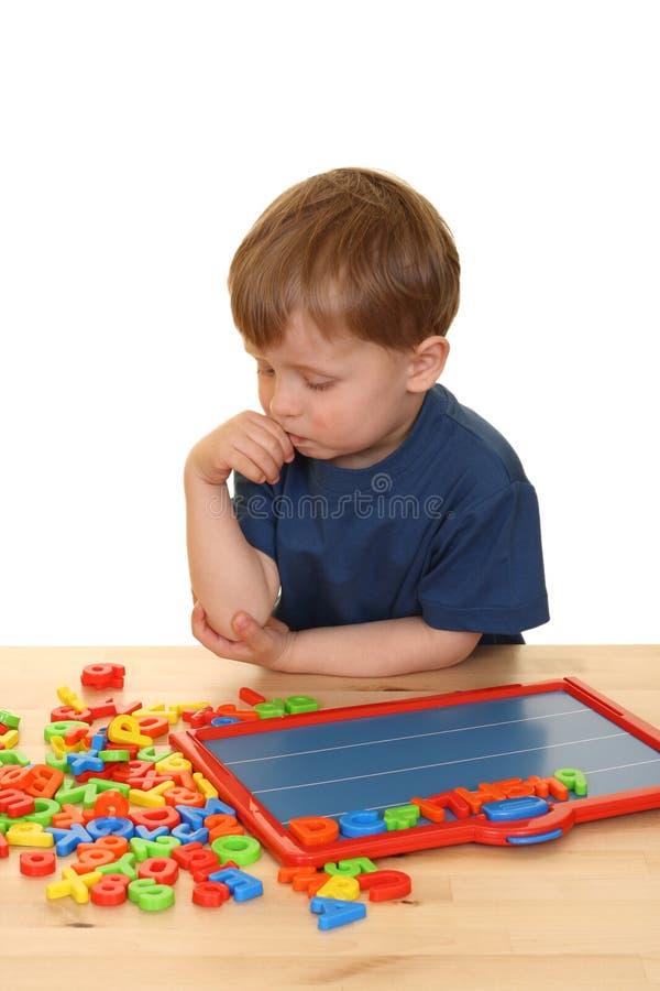Criança e letras imagem de stock royalty free