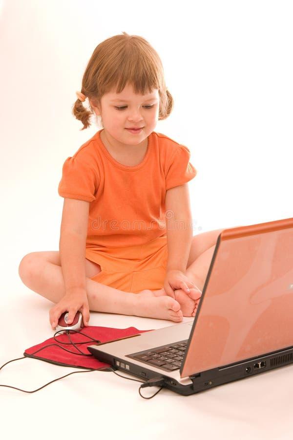 Criança e portátil foto de stock